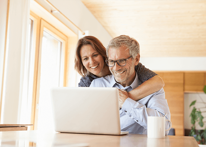 Couple search for something in laptop
